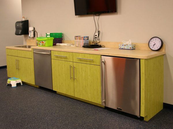 green cabinets and countertops in sports complex