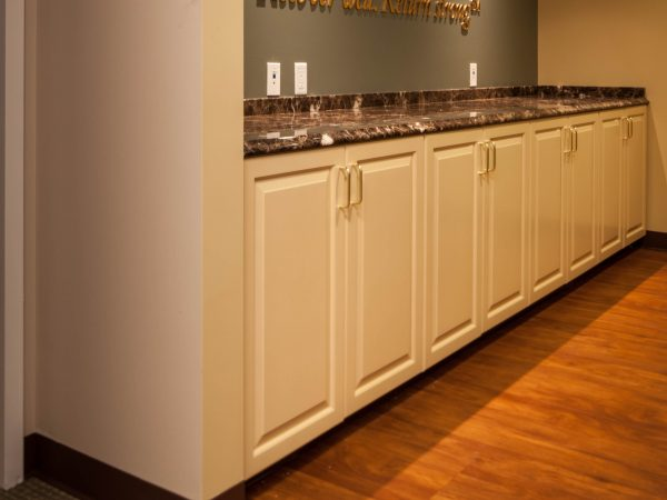 new granite countertop and white cabinets