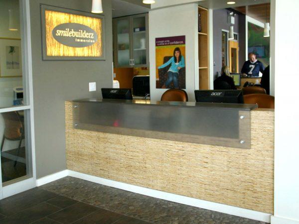 wooden reception desk at dental office
