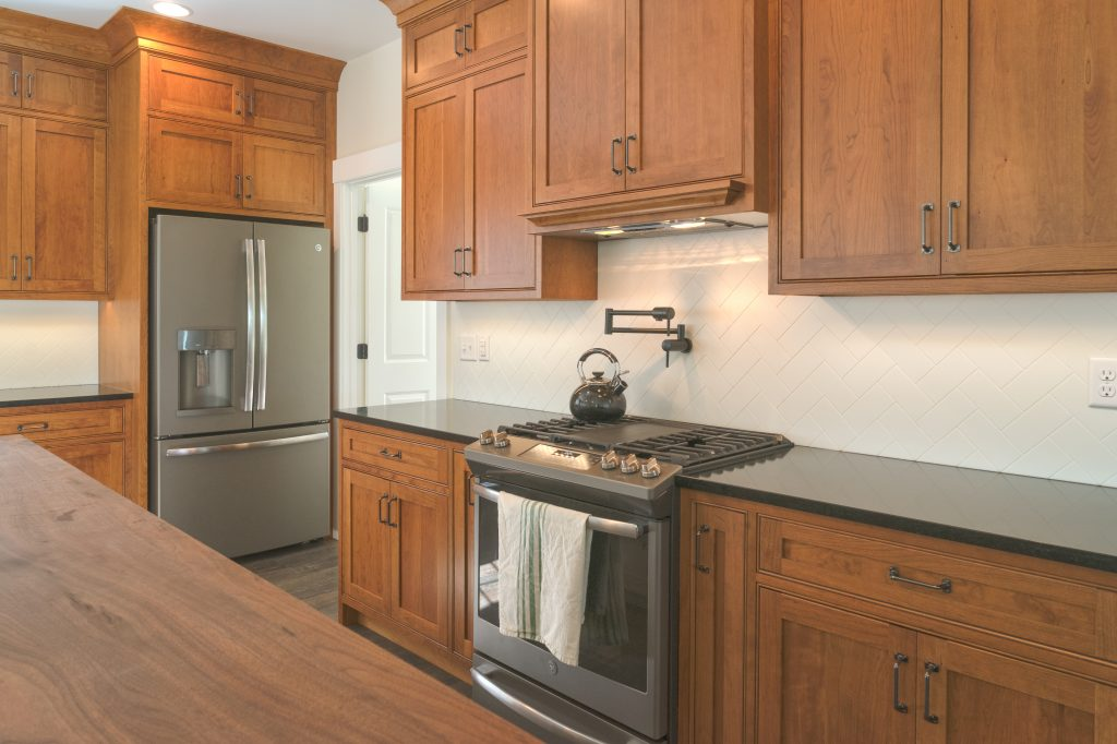 wooden medium stain farmhouse cabinets