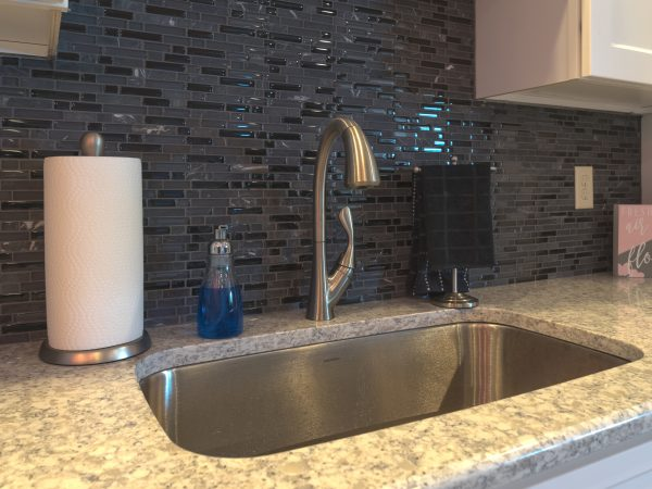 built in sink with marble countertop