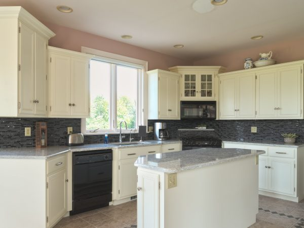 small white Wolf cabinets with marble kitchen island