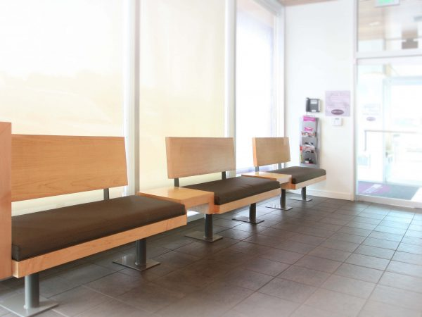 wooden constructed benches in dental office