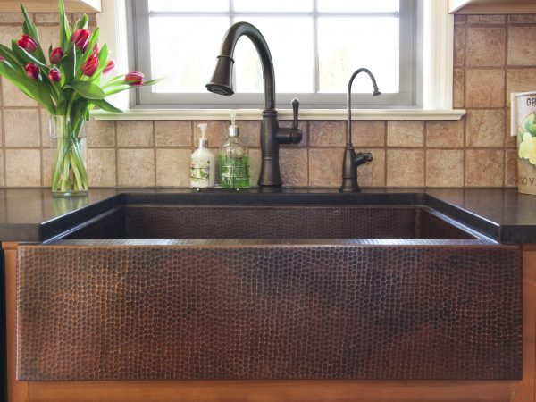 built in sink with black quartz countertops