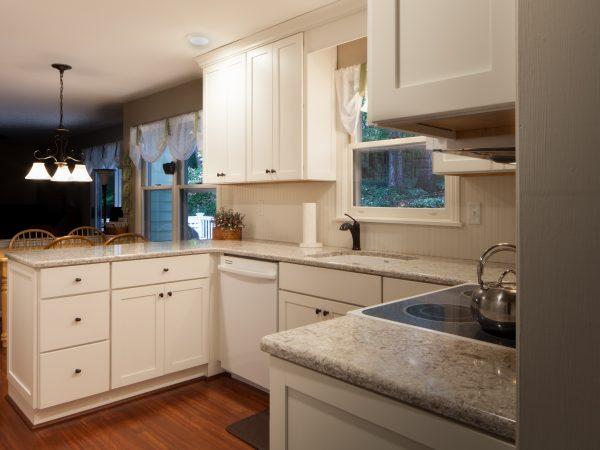 white schrock cabinets with gray granite countertops