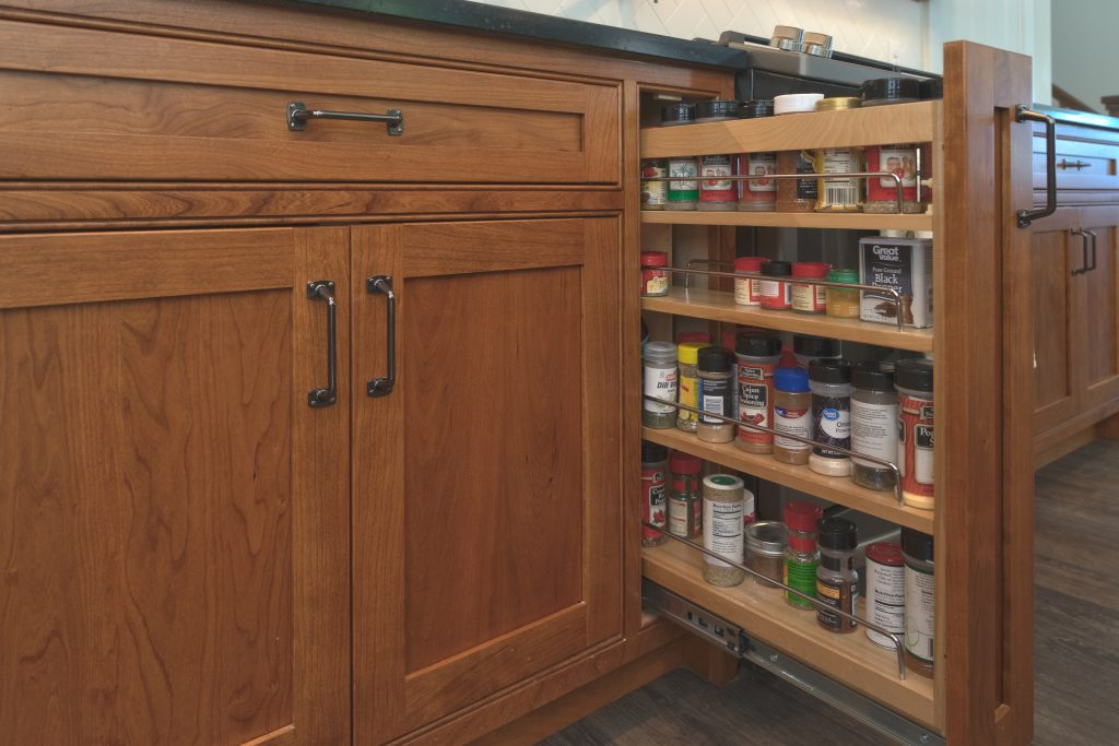 hidden spice rack in wooden cabinets