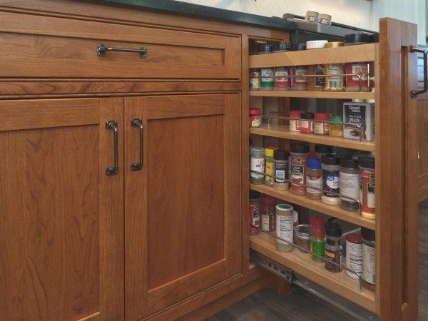 hidden spice rack in wooden cabinets