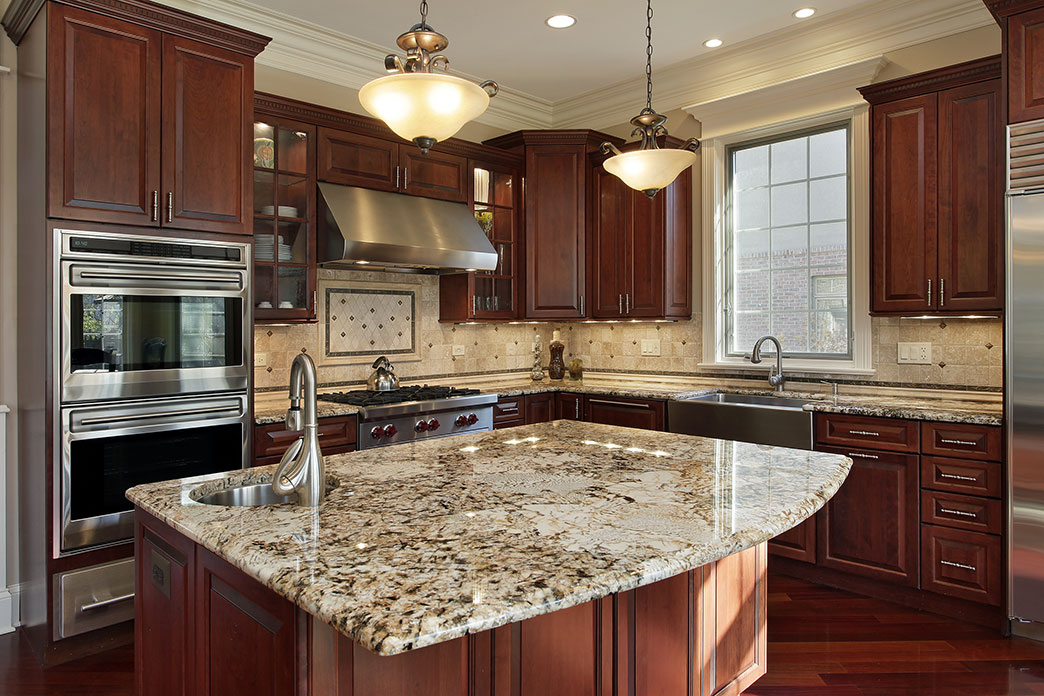 Granite Counters Installed with Dark Cabinetry