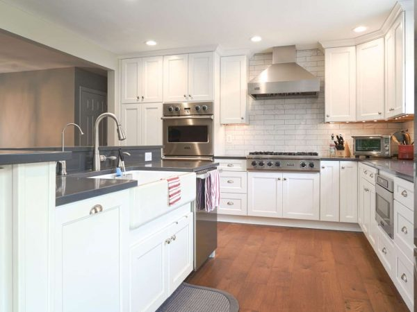 white kitchen cabinets with gray laminate countertop