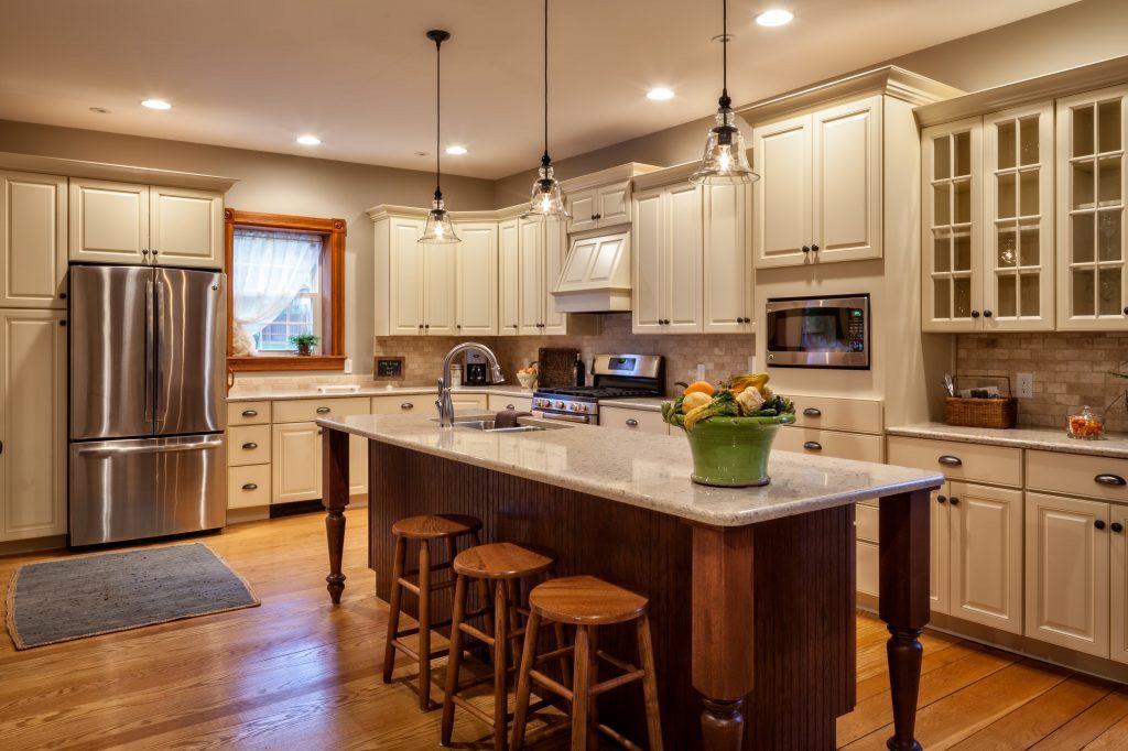 cream kitchen cabinets with quartz countertop