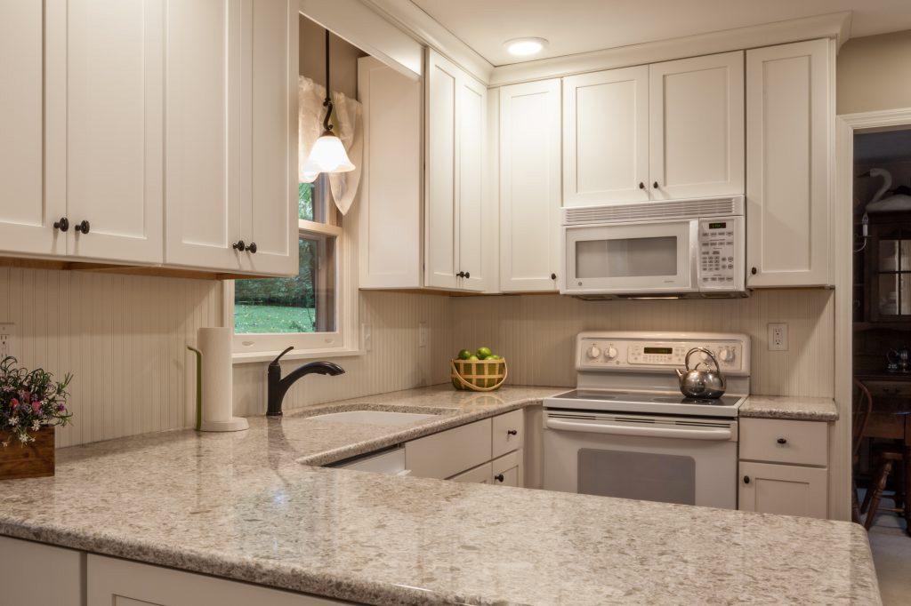 quartz countertops and white kitchen cabinets
