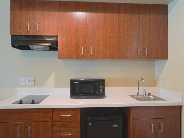 faux wood small kitchen cabinets and white countertop