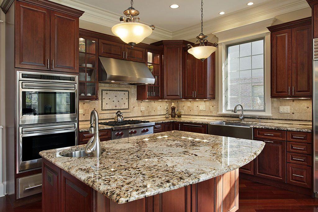 granite kitchen countertop and brown kitchen cabinets
