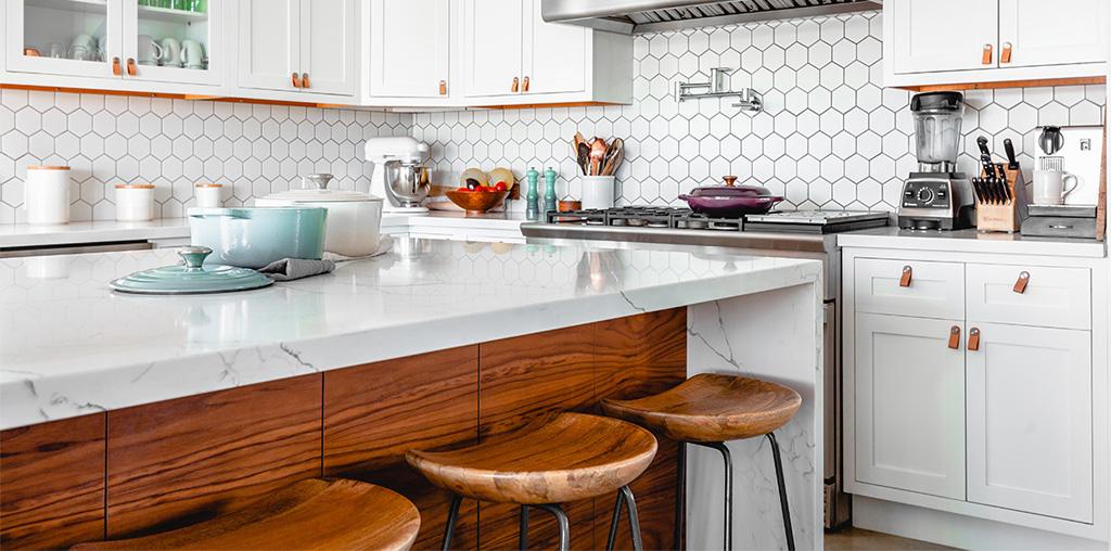 Hexagon tile backsplash in white kitchen