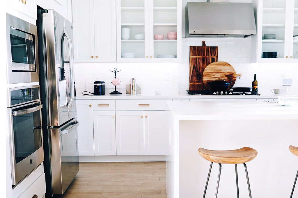 white kitchen countertops and cabinets