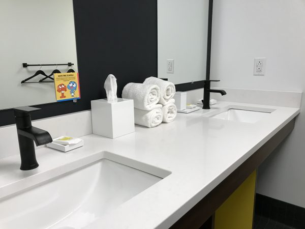 large commercial bathroom in cartoon network hotel