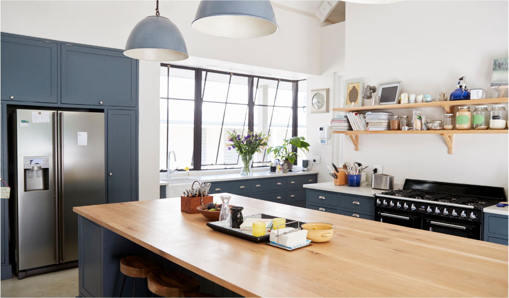 faux wood kitchen island and dark blue kitchen cabinetry