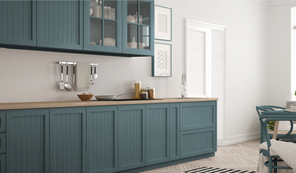 faux wooden countertop and teal green cabinets in kitchen