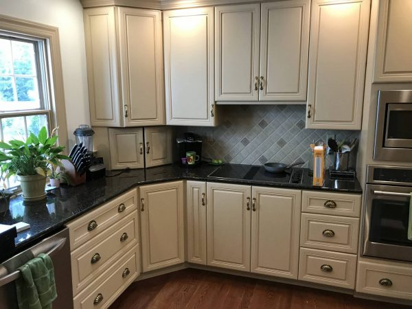 tan cabinets and black laminate countertops