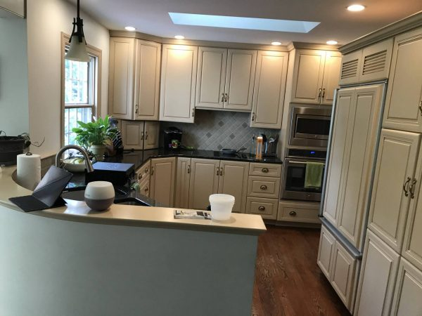 newly installed tan kitchen cabinets