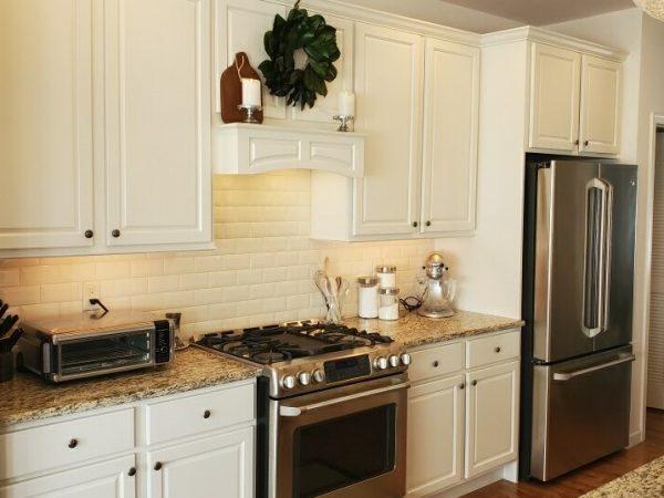 white kitchen overhead kitchen cabinets with granite countertops