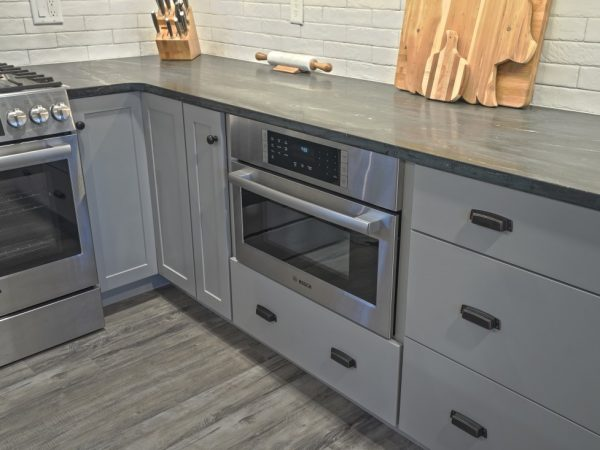 dark gray pull out drawers in new kitchen