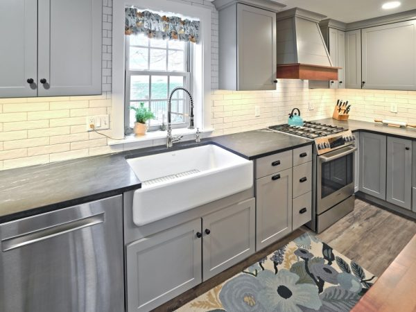 deep farmhouse sink and gray drawers