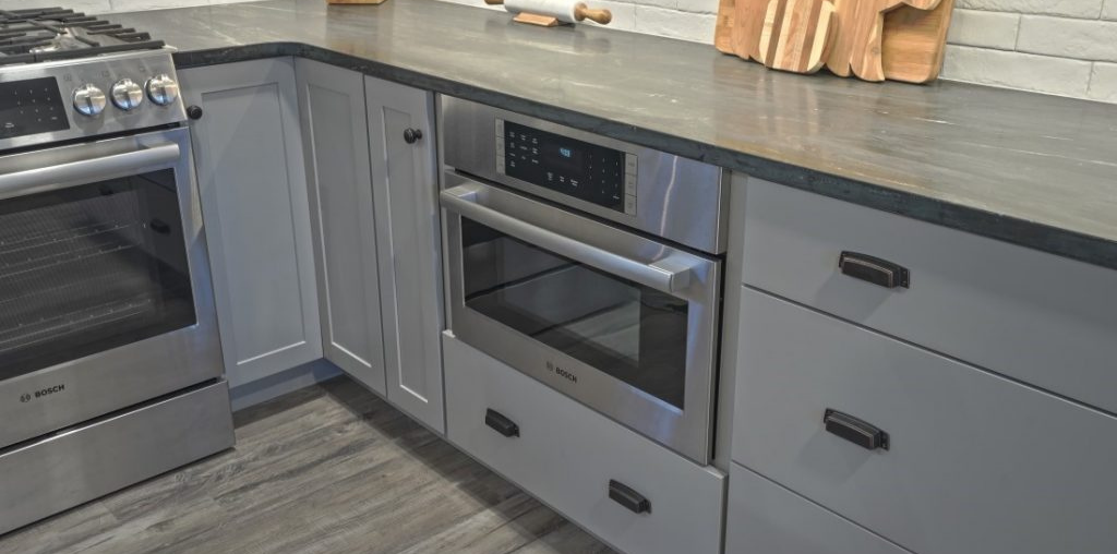 slate gray quartz countertop with gray drawers underneath