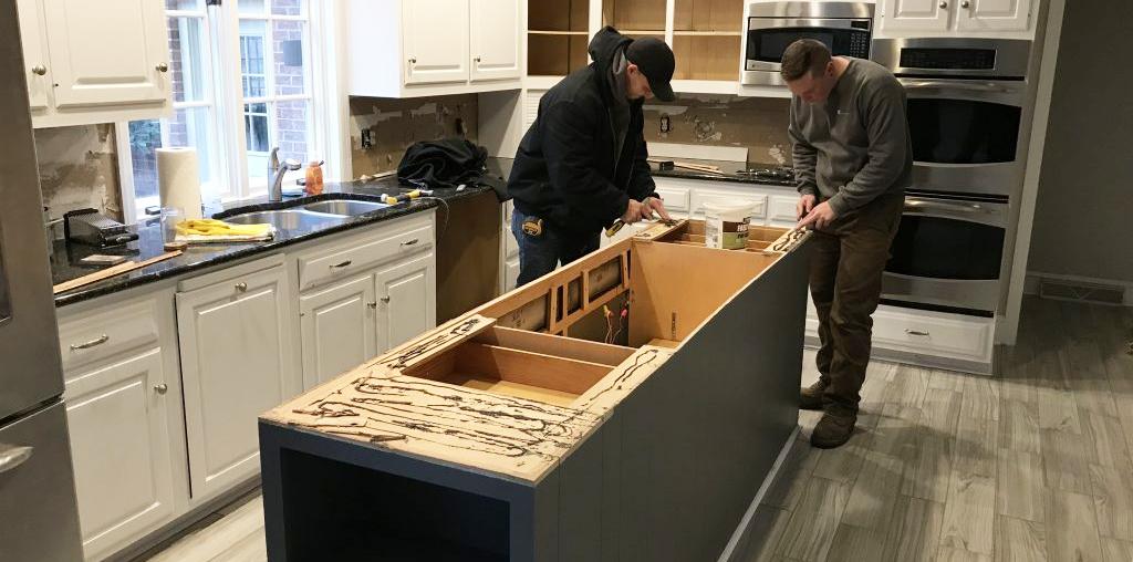 two men working on kitchen island installation
